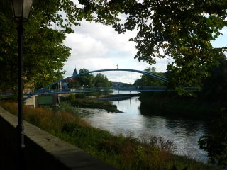 Walking around town on my hunt for an inhaler (Notice the golden rat on top of bridge)