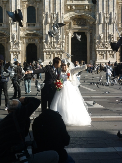 Wedding happening in the main square - doves where everywhere