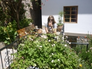 Karina enjoying coca tea in the sun at hotel