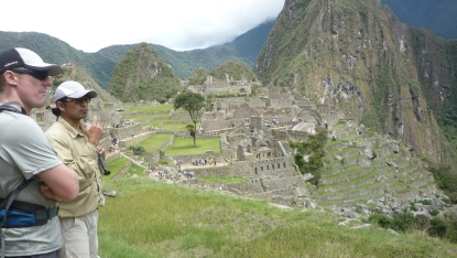 Being guided around Machu Picchu