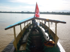 Main form of transport - our boat - Rambo style